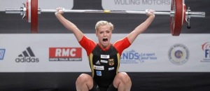 Julia Rohde of Germany competes in the women's 53kg weightlifting competition during the World Weightlifting Championships at Disney Village in Marne-la-Vallee outside Paris November 6, 2011. REUTERS/Benoit Tessier (FRANCE - Tags: SPORT WEIGHTLIFTING)